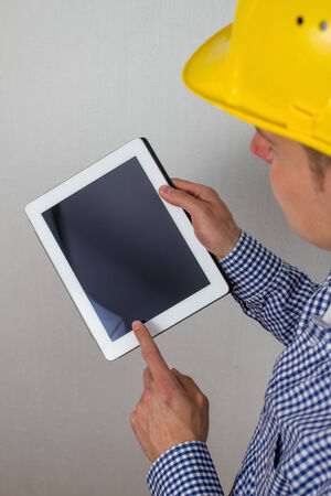 architect with a tablet pc photo