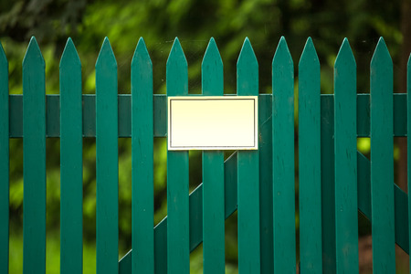 garden fence with a empty sign photo