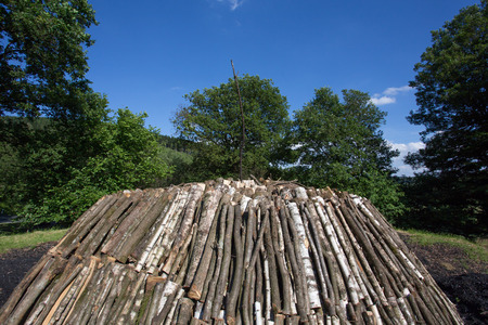kiln: fresh made charcoal kiln in german forest Stock Photo