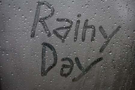 rainy day window letters background Stock Photo
