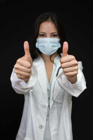 young female doctor making thumbs up photo