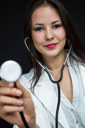 young female doctor with a stethoscope photo