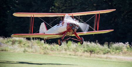 historic: historic biplane on an airfield