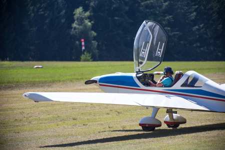 airfield: motorsport airplane on an airfield