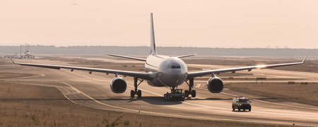 towed: airplane beeing towed on a runway Stock Photo