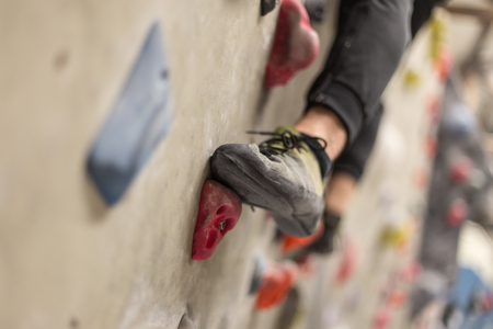 powder room: climbing shoes in boulder climbing hall Stock Photo