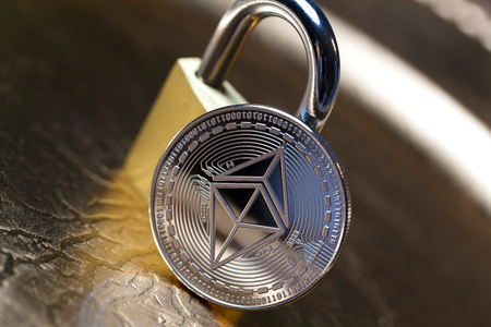 an ethereum coin and a lock