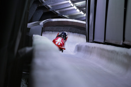 Bob sled speeding in an ice channel Stock Photo