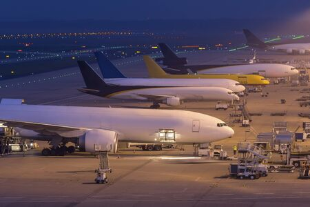 cargo airplanes at an airport at night