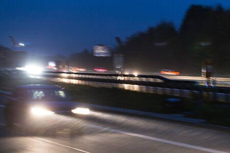 rainy highway traffic at night