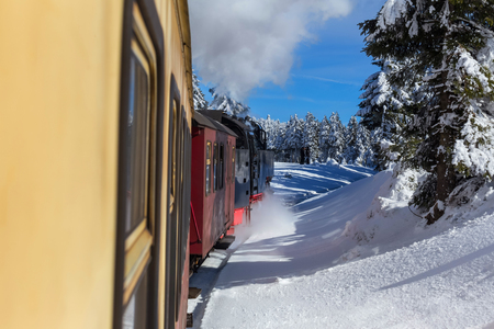 historic steam train in a winter forest Standard-Bild - 97012219