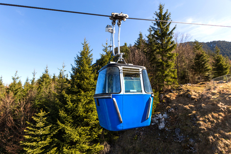 small funicular in front of mountain hills