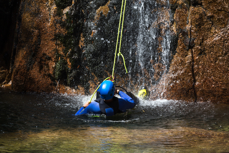 Canyoning climbing on an waterfall