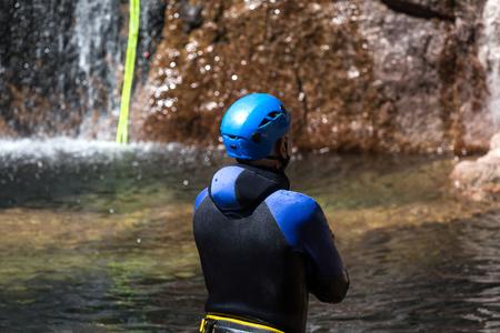 Canyoning climbing on an waterfall