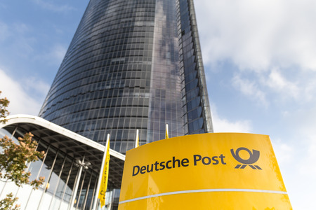 bonn, North Rhine-Westphaliagermany - 19 10 18: deutsche post sign in front of the main post tower in bonn germany