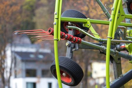 farming rotary tedder on a meadow Stockfoto