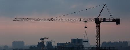 evening cityscape crane