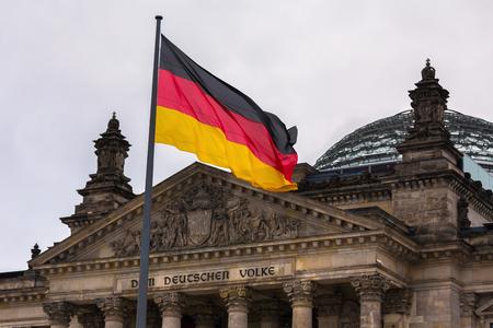 a german flag waving near the german reichtstag