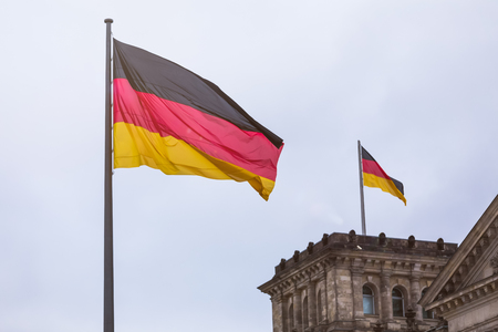 german flags waving near the german reichtstag