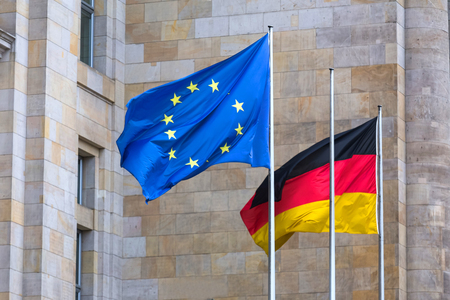 an european and an german flag waving next to each other