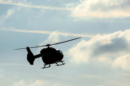 helicopter in flight with clouds