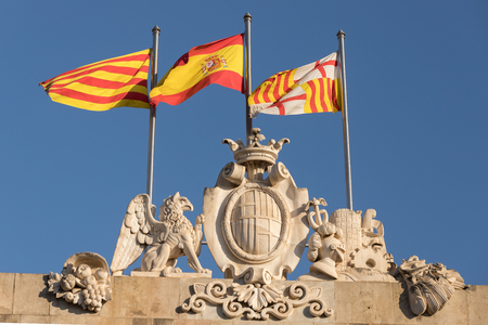 the flags of catalonia, spain and barcelona in the wind Stockfoto