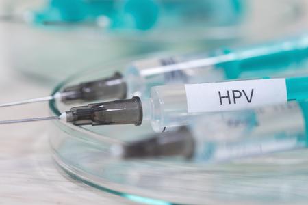 hpv vaccination syringe background
