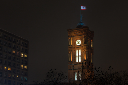 berlin red town hall in the fog at night