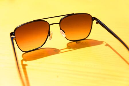summer yellow sunnglasses background Stockfoto