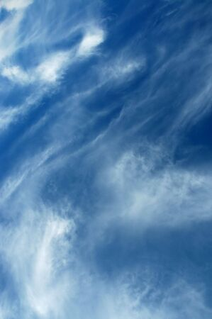 Ocean-like view of a bright blue sky with sweeping clouds. Stock Photo - 3104013