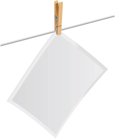 A blank photo attached to a clothes line with a clothes pin. Ilustrace