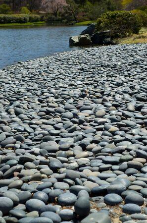 Flat gray stones on a beach Stock Photo - 4634386