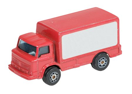 Closeup and isolated image of a toy delivery truck. The side of the truck is blank for placement of advertising.