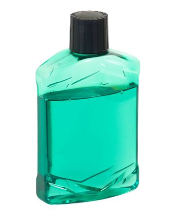 Plastic bottle with green aftershave or pre-shave lotion.