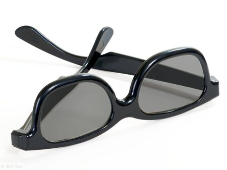 simulate: 3D movie glasses worn at special movie features to simulate a three dimensional effect.