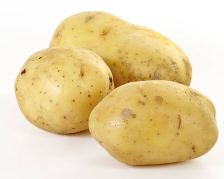 Three Yukon Gold potatoes Stock Photo