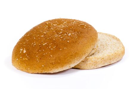 Isolated whole weat hamburger bun with top and bottom separated.