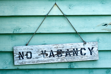 No vacancy sign hanging from rental property in Florida.  Stock Photo