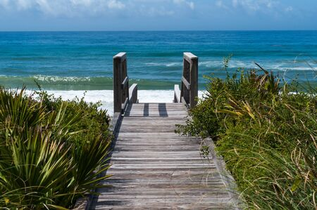 florida landscape: Ocean access boardwalk to Florida Beach, horizontal format.