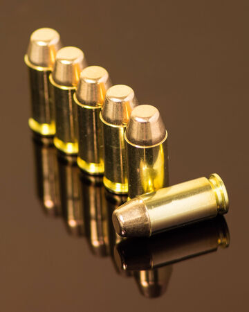 Beauty shot of .40 mm ammunition, on laying down.