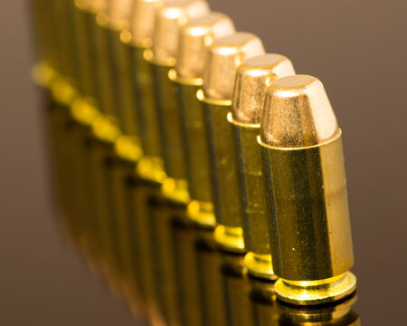 mm: Beauty shot of .40 mm ammunition in a row. Stock Photo