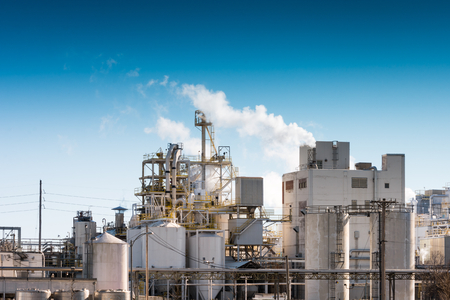 greenhouse gas: View of a modern day factory with minimal emissions. Stock Photo