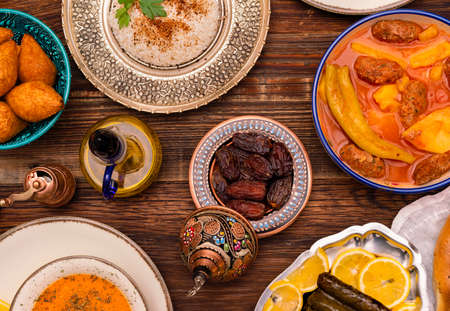 Traditional Turkish dinner include pilaf (boiled rice), lentil soup, Izmir meat balls with potatoes, sarma, kibbeh (aka icli kofte), dried date fruits. Ramadan iftar (evening meal after fasting).