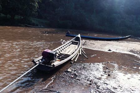 locals: The picture shows the boat used by locals to do fishing in running water.