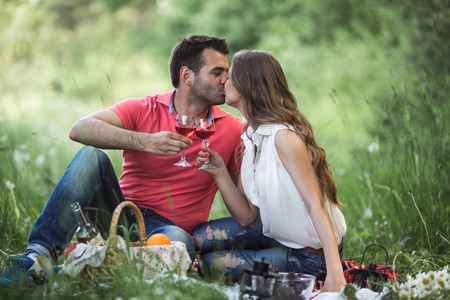 couple at a picnic enjoying life and relaxing