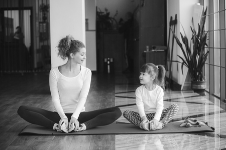 action girl: Two girls of different ages makeing yoga