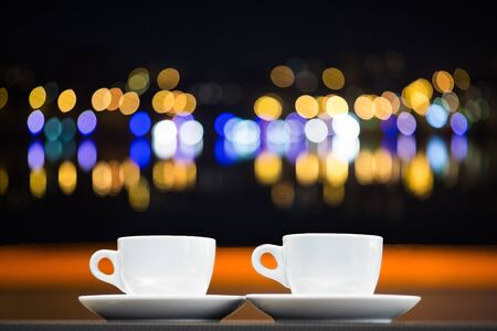 handcarves: two cups of tea and the background with blurred city