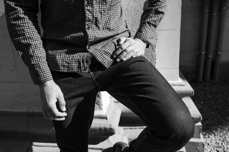 lower body: Lower Body  of Men dressed in selvedge jeans , retro shoes and plaid shirt. Vintage look