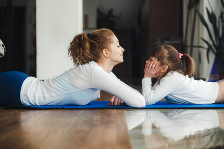 women exercise: Mother and daughter have fun in the gym