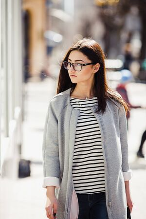 woman  glasses: Beautiful fashion model with glasses shops Stock Photo